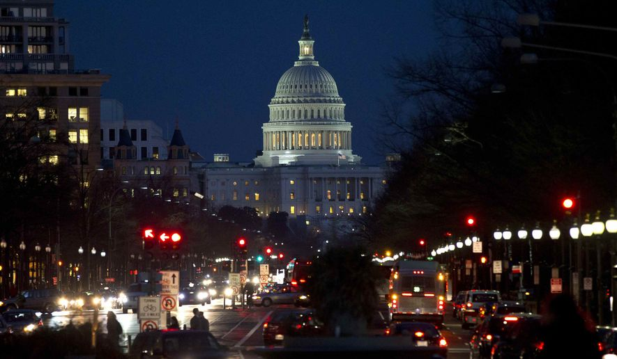Red lights illuminate Pennsylvania Avenue as the U.S. Capitol glows in the twilight, in Washington, Wednesday, Dec. 19, 2012. (AP Photo/Jacquelyn Martin) ** FILE **