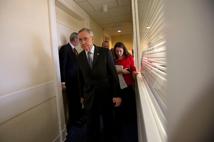 Senate Majority Leader Sen. Harry Reid, D-Nev., leaves a news conference after  speaking about the fiscal cliff at the U.S. Capitol in Washington, on Thursday, Dec. 20, 2012. (AP Photo/Jacquelyn Martin)