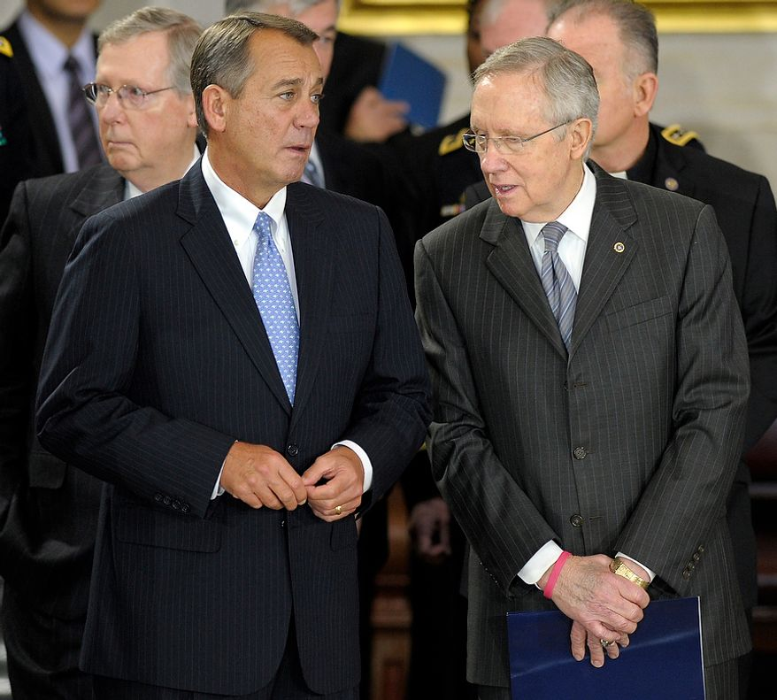 House Speaker John Boehner of Ohio, second from left, speaks with Senate Majority Leader Harry Reid of Nevada, right, before the lying in state of Sen. Daniel Inouye, D-Hawaii, the second-longest-serving senator in history, in the Capitol Rotunda in Washington, Thursday, Dec. 20, 2012. Inouye was a Medal of Honor recipient who represented his state in the U.S. House and then the Senate, where he served for five decades. He died Monday evening at age 88 of respiratory complications. (AP Photo/Susan Walsh)