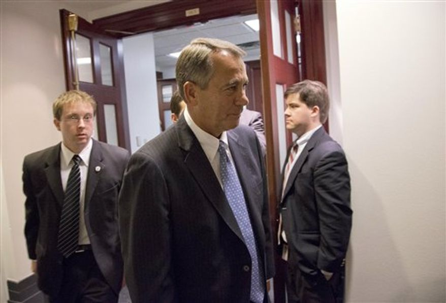 Speaker John A. Boehner of Ohio, center, departs after a House Republicans meeting on Capitol Hill, Thursday, Dec. 20, 2012. Confronted with a revolt among the rank and file, House Republicans abruptly put off a vote Thursday night on legislation allowing tax rates to rise for households earning $1 million and up. (AP Photo/Alex Brandon)