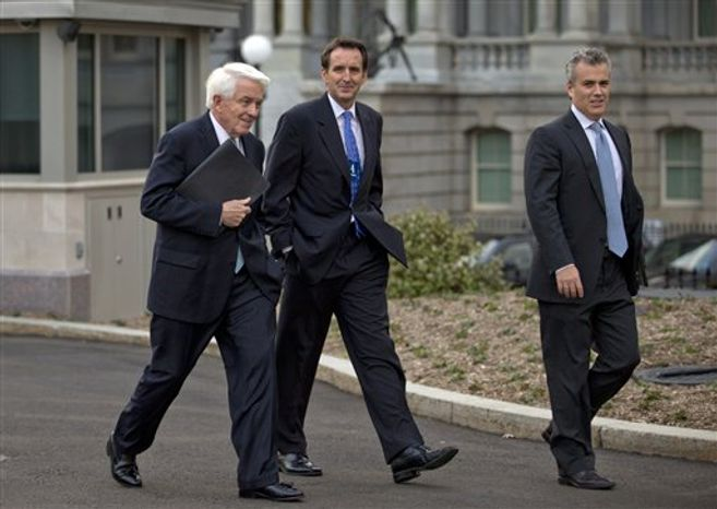 From left, U.S. Chamber of Commerce Chief Executive Tom Donohue, former Minnesota Gov. and GOP presidential candidate Tim Pawlenty, and, Jeffrey Zients of the Office of Management and Budget, walk from the White House after a meeting with White House staff regarding the fiscal cliff, Wednesday, Dec. 19, 2012, in Washington. (AP Photo/Carolyn Kaster)