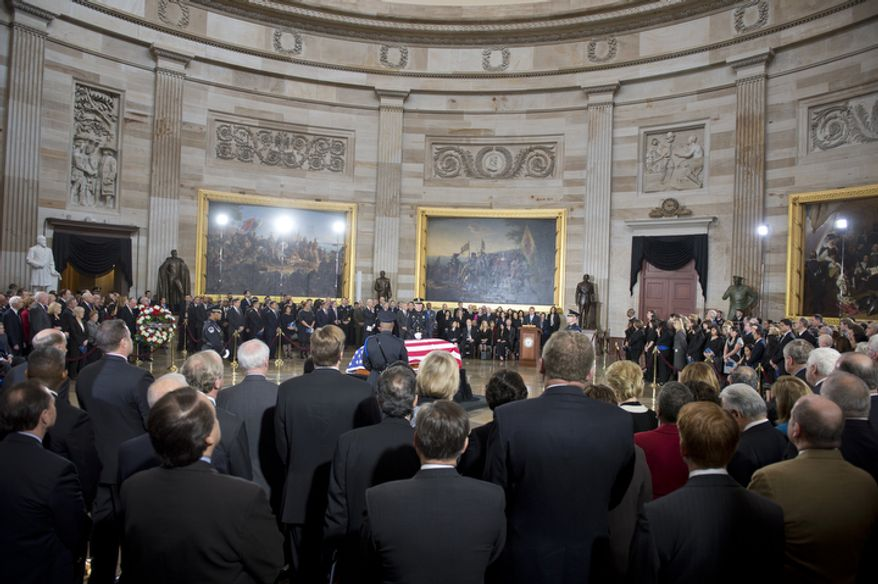 Members of Congress and congressional staff gather for a memorial service for the late Sen. Daniel K. Inouye, Hawaii Democrat, on Thursday, Dec. 20, 2012, in the Rotunda of the U.S. Capitol in Washington. Mr. Inouye, who served as a U.S. senator for 50 years, is only the 31st person to lie in state in the Rotunda. (Barbara L. Salisbury/The Washington Times)