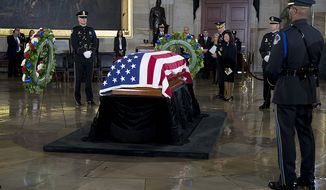 Irene Hirano Inouye, the widow of Sen. Daniel K. Inouye, pays her respects before her husband's casket following a memorial service in the Rotunda of the U.S. Capitol in Washington on Thursday, Dec. 20, 2012. Sen. Inouye was the second-longest-serving senator in U.S. history. (Barbara L. Salisbury/The Washington Times)
