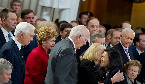 Irene Hirano Inouye, the widow of the late Sen. Daniel Inouye, embraces other U.S. senators following a memorial service at the U.S. Capitol rotunda on Thursday, Dec. 20, 2012. Sen. Inouye, who served as a U.S. senator for 50 years, is only the 31st person to lie in state in the rotunda of the U.S. Capitol. It is seen as a sign of respect. (Barbara L. Salisbury/The Washington Times)