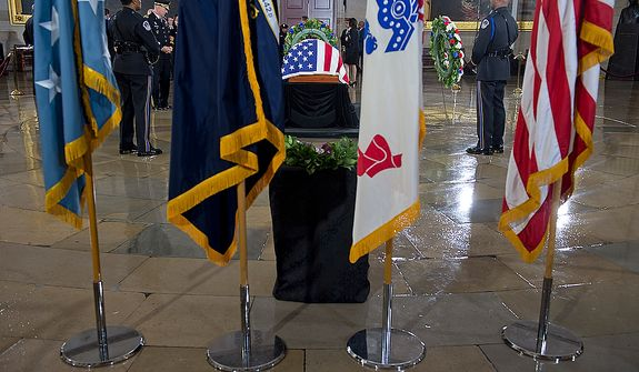 U.S. Capitol Police stand guard over the casket of the late Sen. Daniel Inouye following a memorial service in the U.S. Capitol rotunda on Thursday, Dec. 20, 2012. Sen. Inouye, who served as a U.S. senator for 50 years, is only the 31st person to lie in state in the rotunda of the U.S. Capitol. It is seen as a sign of respect. (Barbara L. Salisbury/The Washington Times)