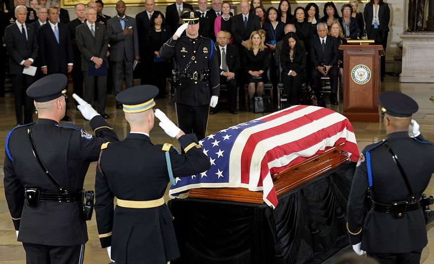 The Capitol Hill Police and military honor guard salute as Sen. Daniel Inouye, D-Hawaii, the second-longest-serving senator in history, lies in state in the Capitol Rotunda in Washington, Thursday, Dec. 20, 2012. Inouye was a Medal of Honor recipient who represented his state in the U.S. House and then the Senate, where he served for five decades. He died Monday evening at age 88 of respiratory complications. (AP Photo/Susan Walsh)
