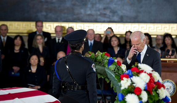 Vice Pres. Joe Biden crosses himself after laying a wreath during a memorial service for the late Sen. Daniel Inouye on at the U.S. Capitol rotunda on Thursday, Dec. 20, 2012. The vice president, who served with Inouye in the Senate and was very close with him, delivered the eulogy. (Barbara L. Salisbury/The Washington Times)