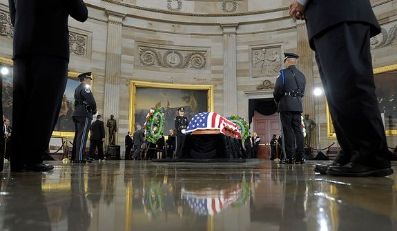 Sen. Daniel Inouye, D-Hawaii, the second-longest-serving senator in history, lies in state in the Capitol Rotunda in Washington, Thursday, Dec. 20, 2012. Inouye was a Medal of Honor recipient who represented his state in the U.S. House and then the Senate, where he served for five decades. He died Monday evening at age 88 of respiratory complications. (AP Photo/Susan Walsh)