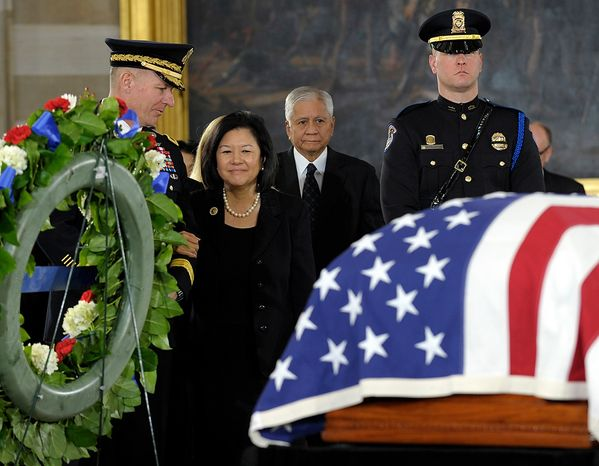 Irene Hirano Inouye, widow of Sen. Daniel Inouye, D-Hawaii, who was the second-longest-serving senator in history, looks at the casket of her husband as he lies in state in the Capitol Rotunda in Washington, Thursday, Dec. 20, 2012. Sen. Inouye was a Medal of Honor recipient who represented his state in the U.S. House and then the Senate, where he served for five decades. He died Monday evening at age 88 of respiratory complications. (AP Photo/Susan Walsh)