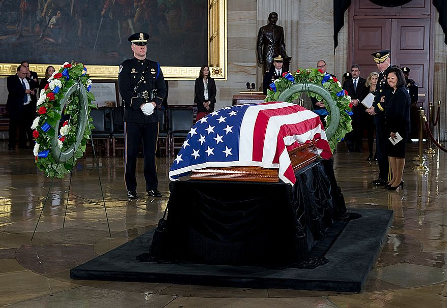 Irene Hirano Inouye, the widow of the late Sen. Daniel Inouye, pays her last respects to her husband's casket following a memorial service at the U.S. Capitol rotunda on Thursday, Dec. 20, 2012. Sen. Inouye, who served as a U.S. senator for 50 years, is only the 31st person to lie in state in the rotunda of the U.S. Capitol. It is seen as a sign of respect. (Barbara L. Salisbury/The Washington Times)