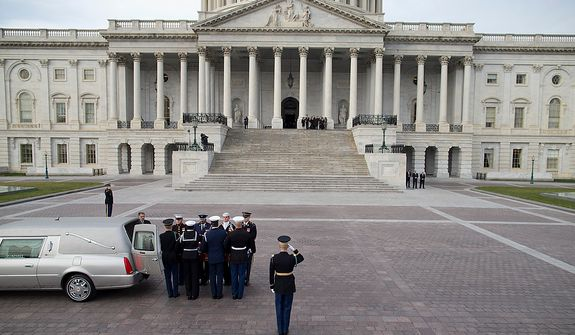 The casket of Sen. Daniel Inouye, D- Hawaii, is carried into the Capitol to lie in state in the Capitol Rotunda on Thursday, Dec. 20, 2012 in Washington.  Inouye has been in public office since 1959, and was awarded the Medal of Honor for his service in Europe in World War II.  (AP Photo/ Evan Vucci)