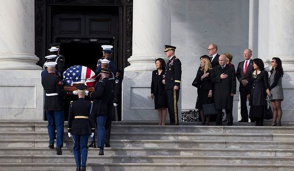 Family members of Sen. Daniel Inouye, D- Hawaii, look on as his casket is carried into the Capitol to lie in state in the Capitol Rotunda on Thursday, Dec. 20, 2012 in Washington.  Inouye has been in public office since 1959, and was awarded the Medal of Honor for his service in Europe in World War II.  (AP Photo/ Evan Vucci)