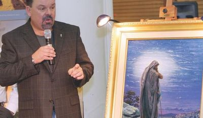 """** FILE ** Artist Thomas Kinkade unveils his painting """"Prayer for Peace"""" at the opening of the exhibit """"From Abraham to Jesus"""" in Atlanta in September 2006. Kinkade, 54, the self-described """"Painter of Light,"""" died April 6, 2012, at his home in Los Gatos, Calif. (AP Photo/Gene Blythe)"""