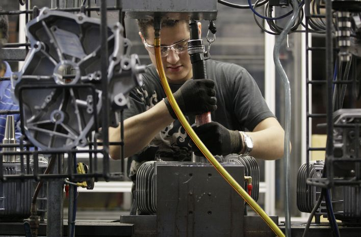 Jesus Serna works on the assembly line at Generac Power Systems Inc., one of the largest makers of residential generators in the United States, in Whitewater, Wis., on Friday, Nov. 16, 2012. (AP Photo/Nam Y. Huh)