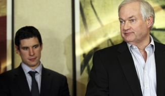 Pittsburgh Penguins' Sidney Crosby, left, listens as Don Fehr, executive director for the National Hockey League Players Associations, speaks to reporters on Thursday, Dec. 6, 2012, in New York. Talks in the NHL labor fight broke down after just one hour on Thursday night, and it is not known when the league and the players' association would get back together. (AP Photo/Mary Altaffer)