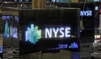 NYSE logos top trading posts on the floor of the New York Stock Exchange Thursday, Dec. 20, 2012. (AP Photo/Richard Drew)