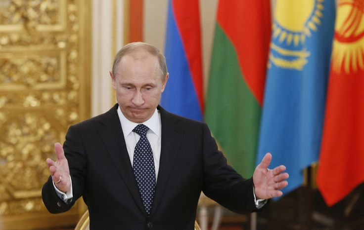 Russian President Vladimir Putin welcomes the leaders of member countries of the Collective Security Treaty Organization (CSTO) in Moscow on Wednesday, Dec. 19, 2012. (AP Photo/Yuri Kochetkov, Pool)