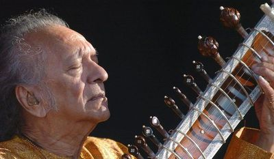 ** FILE ** In this July 19, 2005, file photo, Indian musician Ravi Shankar performs during the opening day of the Paleo Festival, in Nyon, Switzerland. Shankar, the sitar virtuoso who became a hippie musical icon of the 1960s after hobnobbing with the Beatles and who introduced traditional Indian ragas to Western audiences over an eight-decade career, died Tuesday, Dec. 11, 2012. (AP Photo/Keystone, Sandro Campardo, File)