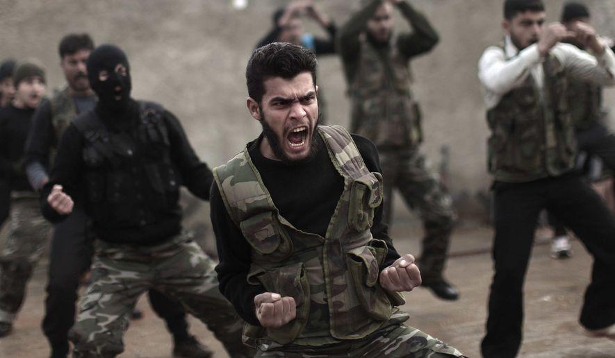 ** File ** Syrian rebels attend a training session in Maaret Ikhwan, near Idlib, Syria, Dec 17, 2012. (Associated Press)