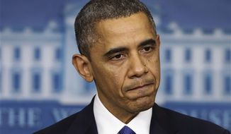 "President Obama pauses as he speaks to reporters about the ""fiscal cliff"" in the Brady Press Briefing Room at the White House in Washington on Friday, Dec. 21, 2012. (AP Photo/Charles Dharapak)"