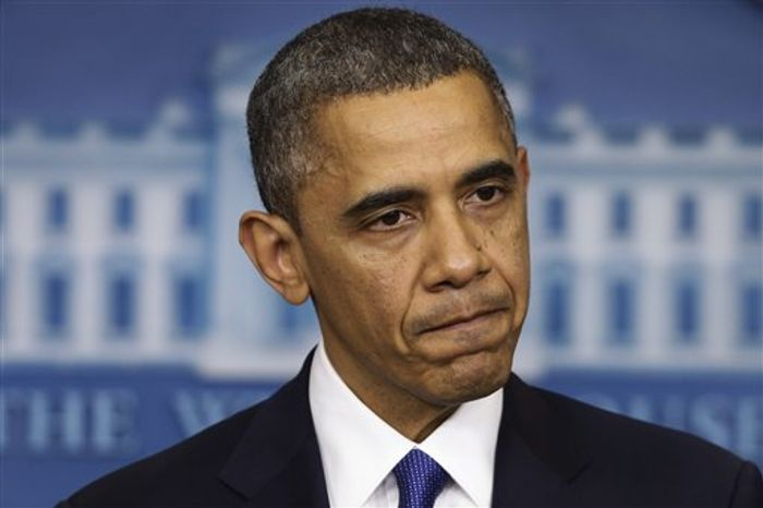 """President Obama pauses as he speaks to reporters about the """"fiscal cliff"""" in the Brady Press Briefing Room at the White House in Washington on Friday, Dec. 21, 2012. (AP Photo/Charles Dharapak)"""
