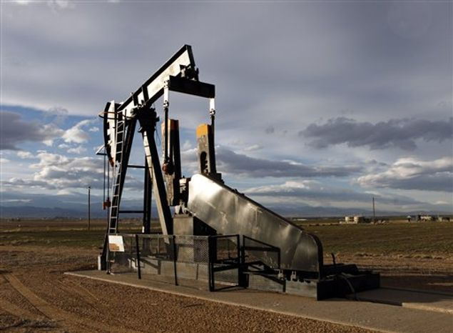 """** FILE ** This Dec. 5, 2012, photo shows an oil pump jack in a field adjacent to a sub-division near Fredrick, Colo. Citizen fears about hydraulic fracturing, a drilling procedure used to pry oil and gas from rock deep underground, have made """"fracking"""" the hottest political question in Colorado."""