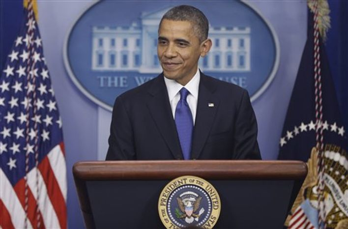 President Barack Obama smiles as he speaks to reporters about the fiscal cliff in the Brady Press Briefing Room at the White House in Washington, Friday, Dec. 21, 2012. (AP Photo/Charles Dharapak)