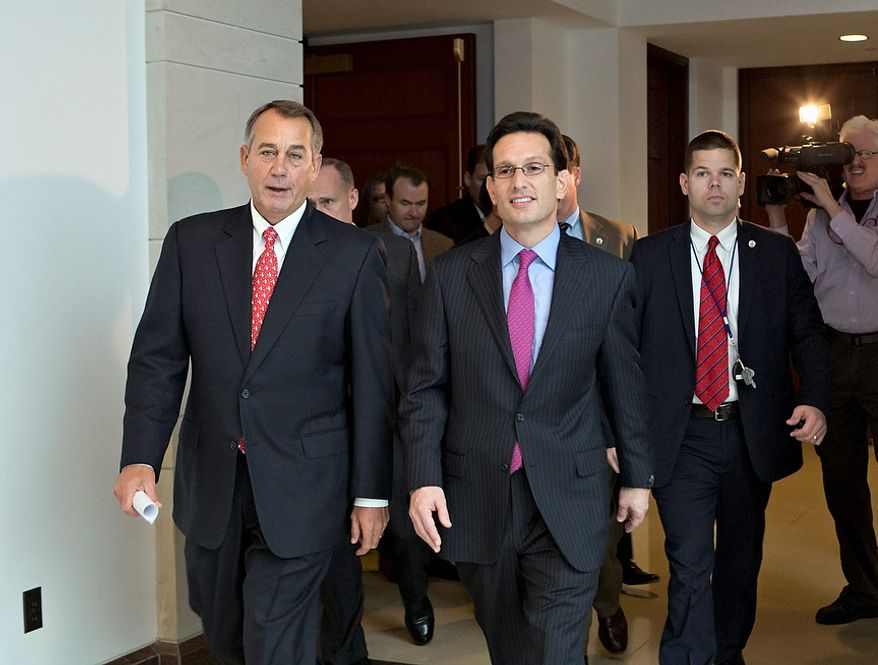 """Speaker of the House John Boehner, R-Ohio, left, joined by House Majority Leader Eric Cantor, R-Va., returns to his office after speaking to reporters on the fiscal cliff negotiations, at the Capitol in Washington, Friday, Dec. 21, 2012. Hopes for avoiding the """"fiscal cliff"""" that threatens the U.S. economy fell Friday after fighting among congressional Republicans cast doubt on whether any deal reached with President Barack Obama could win approval ahead of automatic tax increases and deep spending cuts kick in Jan. 1.  (AP Photo/J. Scott Applewhite)"""