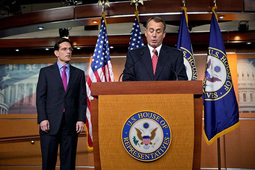 """Speaker of the House John Boehner, R-Ohio, joined by House Majority Leader Eric Cantor, R-Va., speaks to reporters about the fiscal cliff negotiations at the Capitol in Washington, Friday, Dec. 21, 2012. Hopes for avoiding the """"fiscal cliff"""" that threatens the U.S. economy fell Friday after fighting among congressional Republicans cast doubt on whether any deal reached with President Barack Obama could win approval ahead of automatic tax increases and deep spending cuts kick in Jan. 1.  (AP Photo/J. Scott Applewhite)"""