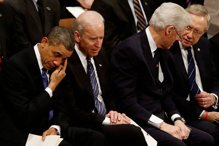 President Barack Obama wipes his eye as he is seated with Vice President Joe Biden, former President Bill Clinton, and Senate Majority Leader Harry Reid at the funeral service for the late Sen. Daniel Inouye, D-Hawaii, at the Washington National Cathedral, Friday, Dec. 21, 2012. (AP Photo/Charles Dharapak)