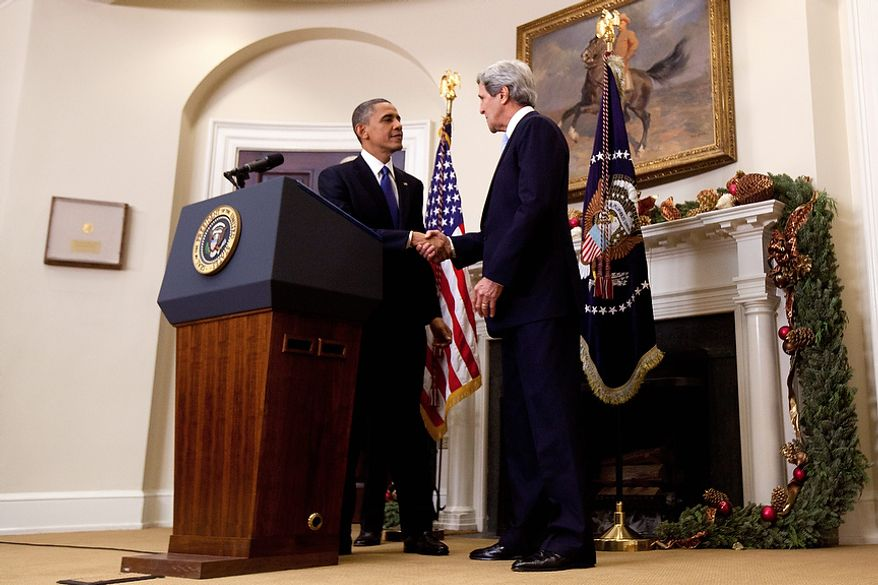 President Barack Obama shakes hands with Sen. John Kerry, D-Mass., his choice to be the next Secretary of State,  as he makes his announcement in the Roosevelt Room of the White House in Washington, Friday, Dec. 21, 2012. (AP Photo/Carolyn Kaster)
