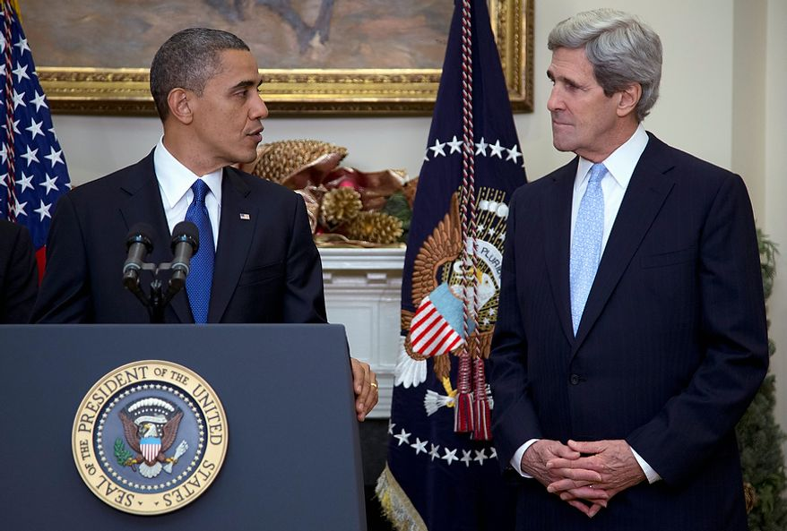 President Barack Obama looks to Sen. John Kerry, D-Mass., as he announces Kerry's  nomination for the next secretary of state in the Roosevelt Room of the White House, Friday, Dec. 21, 2012, in Washington. (AP Photo/Carolyn Kaster)