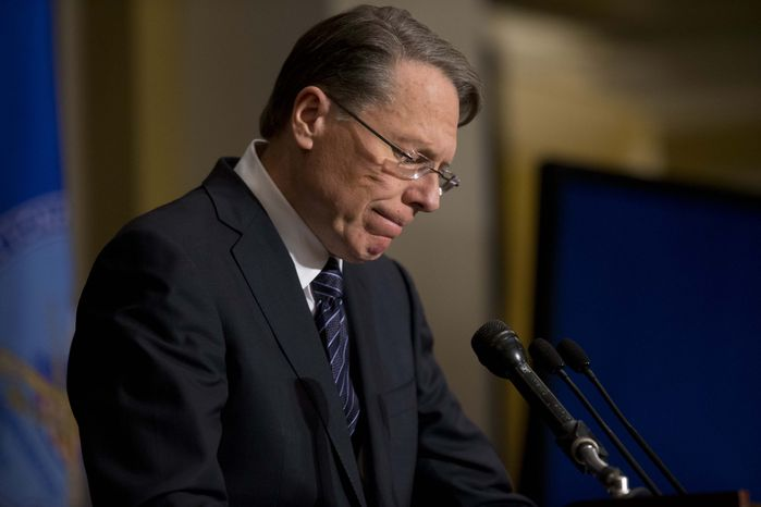 National Rifle Association Executive Vice President Wayne LaPierre pauses as he makes a statement during a news conference in response to the Connecticut school shooting, on Friday, Dec. 21, 2012, in Washington. The National Rifle Association broke its silence Friday on last week's shooting rampage at a Connecticut elementary school that left 26 children and staff dead. (AP Photo/ Evan Vucci)