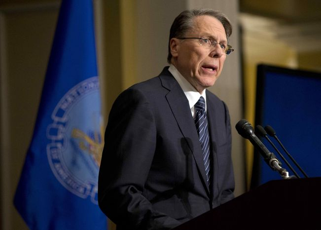 """The National Rifle Association Executive Vice President Wayne LaPierre speaks during a news conference in response to the Connecticut school shooting on Friday, Dec. 21, 2012, in Washington. The nation's largest gun-rights lobby is calling for armed police officers to be posted in every American school to stop the next killer """"waiting in the wings."""" (AP Photo/ Evan Vucci)"""