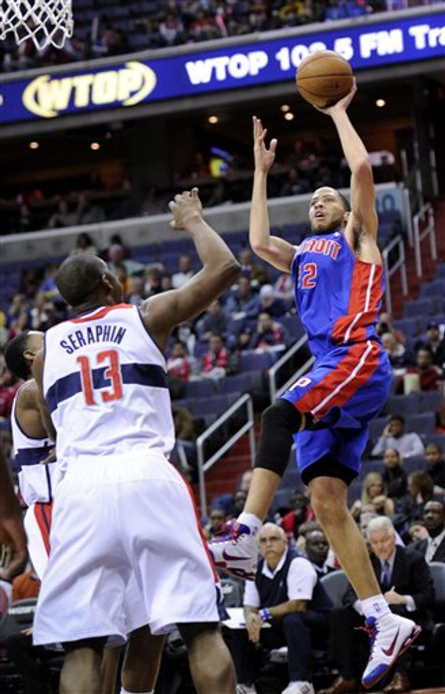 Detroit Pistons forward Tayshaun Prince (22) releases a shot in front of Washington Wizards forward Kevin Seraphin (13) during the first half of an NBA basketball game, Saturday, Dec. 22, 2012, in Washington. (AP Photo/Nick Wass)