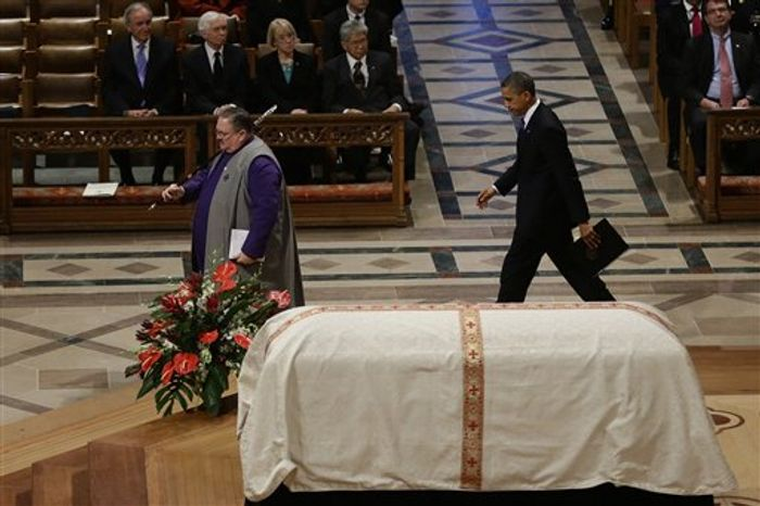 President Barack Obama, walks past the casket of the late Sen. Daniel Inouye D-Hawaii, at his funeral service at Washington National Cathedral, Friday, Dec. 21, 2012. (AP Photo/Charles Dharapak)