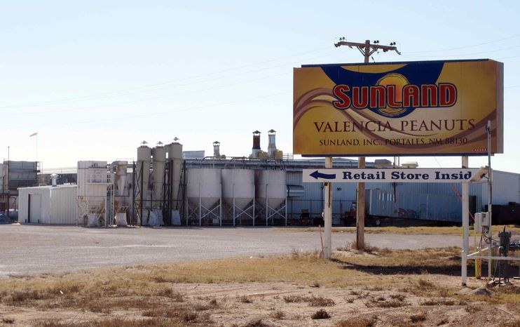 ** FILE ** This Nov. 27, 2012, file photo shows the Sunland Inc. peanut butter and nut processing plant in eastern New Mexico, near Portales, which has been shuttered since late September due to a salmonella outbreak that sickened dozens. (AP Photo/Jeri Clausing, File)