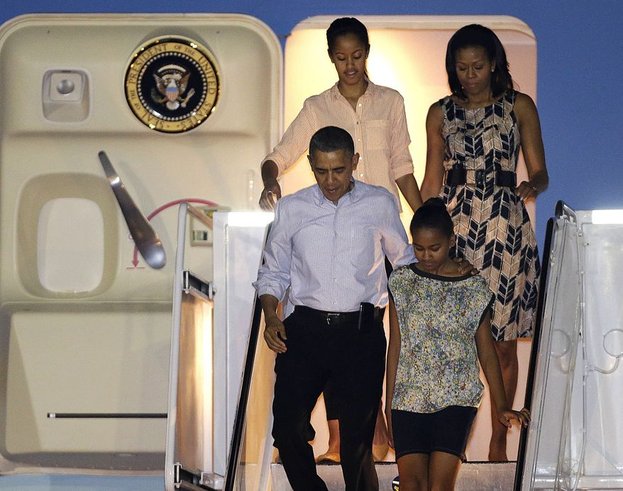 ** FILE ** President Barack Obama arrives with first lady Michelle Obama, top, and daughters Malia, top left, and Sasha, bottom right, at Honolulu Joint Base Pearl Harbor-Hickam in Honolulu, for the start of their holiday vacation, Saturday, Dec. 22, 2012. (AP Photo/Gerald Herbert)