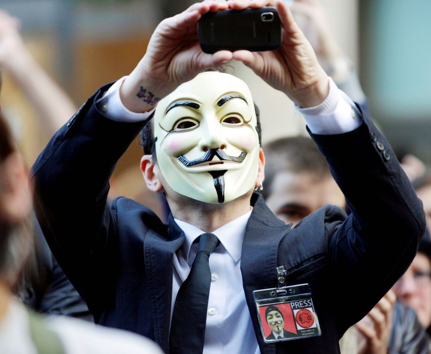 "An ""Occupy Seattle"" protester wears a Guy Fawkes mask while demonstrating in October 2011. Guy Fawkes masks are featured prominently in ""V for Vendetta,"" which was telecast Friday in China. (Associated Press)"