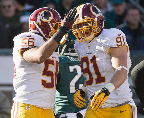 Washington Redskins inside linebacker Perry Riley (56) congratulates Washington Redskins outside linebacker Ryan Kerrigan (91) after sacking Philadelphia Eagles quarterback Nick Foles (9) as the Washington Redskins play the Philadelphia Eagles at Lincoln Financial Field, Philadelphia, Pa., Sunday, December 23, 2012. (Andrew Harnik/The Washington Times)