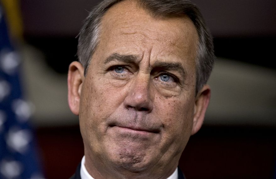 """House Speaker John A. Boehner, Ohio Republican, speaks to reporters about the """"fiscal cliff"""" negotiations at the Capitol in Washington on Friday, Dec. 21, 2012. (AP Photo/J. Scott Applewhite)"""