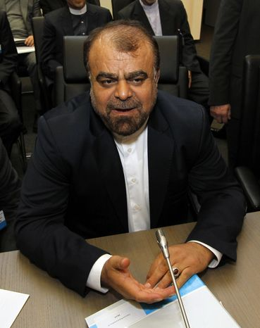 Iranian Minister of Petroleum Rostam Ghasemi speaks to journalists before the start of the meeting of the Organization of the Petroleum Exporting Countries (OPEC) at its headquarters in Vienna, Austria, on Wednesday, Dec. 12, 2012. (AP Photo/Ronald Zak)