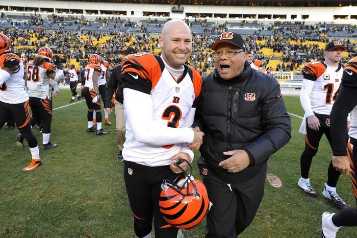 Cincinnati Bengals kicker Josh Brown (3) celebrates with running backs coach Jim Anderson following an NFL football game against the Pittsburgh Steelers on Sunday, Dec. 23, 2012, in Pittsburgh. Cincinnati won 13-10 on a 43-yard field goal from Brown.(AP Photo/Don Wright)
