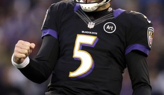 Baltimore Ravens quarterback Joe Flacco reacts after throwing a touchdown pass to wide receiver Torrey Smith in the first half of an NFL football game against the New York Giants in Baltimore, Sunday, Dec. 23, 2012. (AP Photo/Evan Vucci)