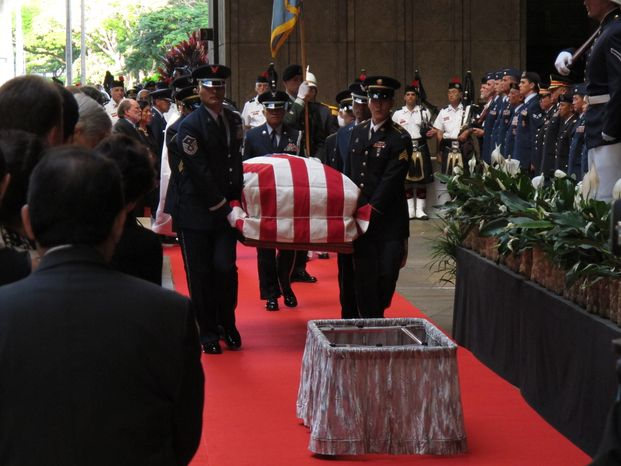Pallbearers carry the casket of U.S. Sen. Daniel K. Inouye into the courtyard of the Hawaii Capitol during a visitation ceremony in Honolulu on Saturday, Dec. 22, 2012. (AP Photo/Oskar Garcia)
