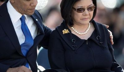 President Barack Obama, left, comforts Irene Hirano Inouye, the widow of the late Sen. Daniel Inouye, D-Hawaii, during a memorial service for the late senator, at the National Memorial Cemetery of the Pacific, Sunday, Dec. 23, 2012, in Honolulu. The 88-year-old Inouye died of respiratory complications on Dec. 17. (AP Photo/Carolyn Kaster)