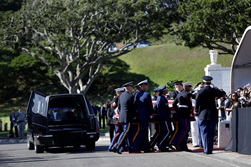 An honor guard carries the casket Sen. Daniel Inouye, D-Hawaii, at his memorial Service, at the Punchbowl National Memorial Cemetery of the Pacific in Honolulu, Sunday, Dec. 23, 2012. (AP Photo/Gerald Herbert)