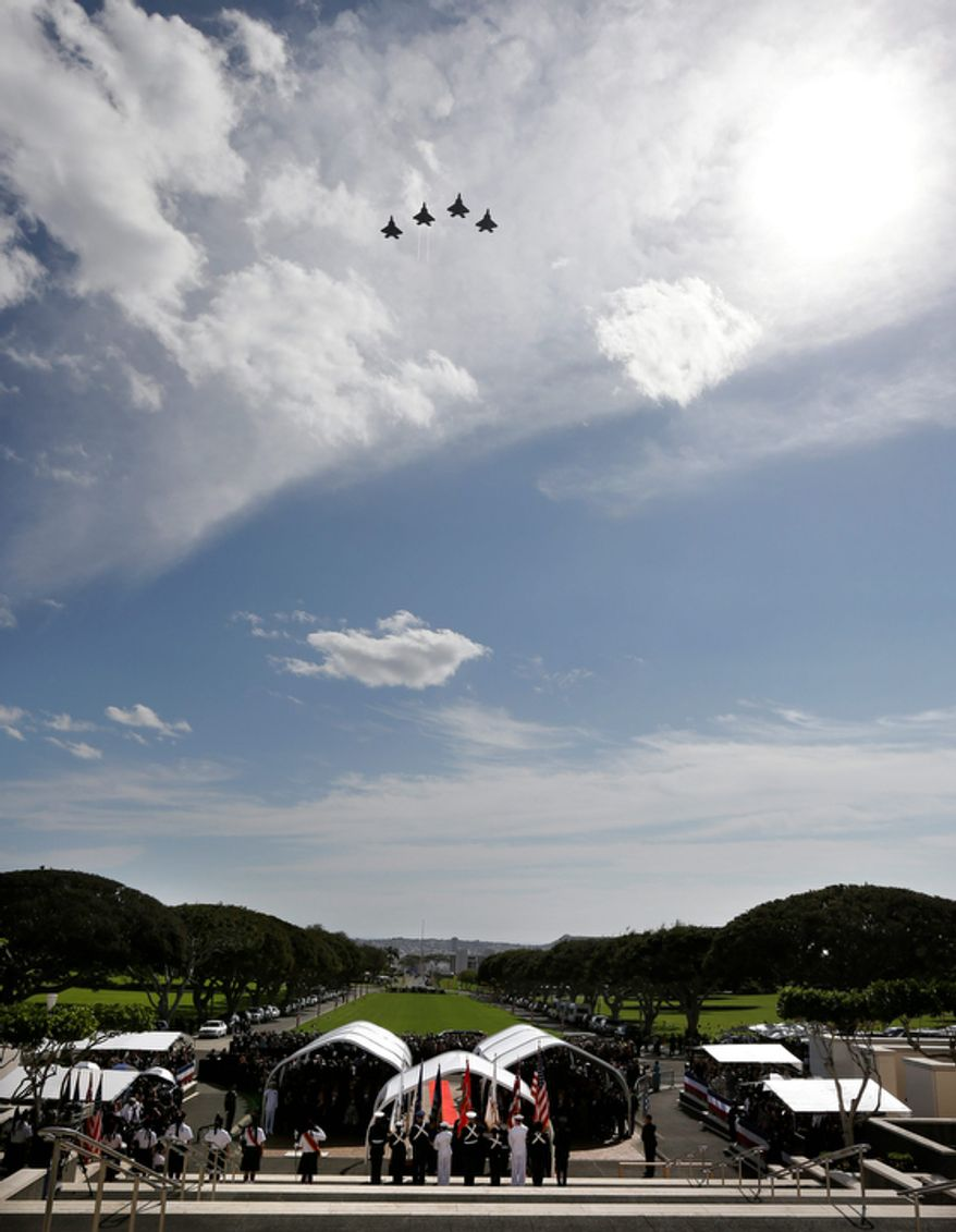 Military jets perform a flyover during the Memorial Service for Sen. Daniel Inouye, D-Hawaii, attended by President Barack Obama, at the Punchbowl National Memorial Cemetery of the Pacific in Honolulu, Sunday, Dec. 23, 2012. (AP Photo/Gerald Herbert)