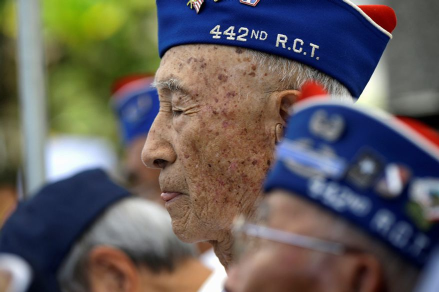 World War II veterans listen during the memorial service for Sen. Daniel Inouye, D-Hawaii, at the Punchbowl National Memorial Cemetery of the Pacific in Honolulu, Sunday, Dec. 23, 2012. Inouye was the first Japanese-American elected to both houses of Congress and the second-longest serving senator in U.S. history, at 50 years. He died Dec. 17 at age 88. (AP Photo/Gerald Herbert)