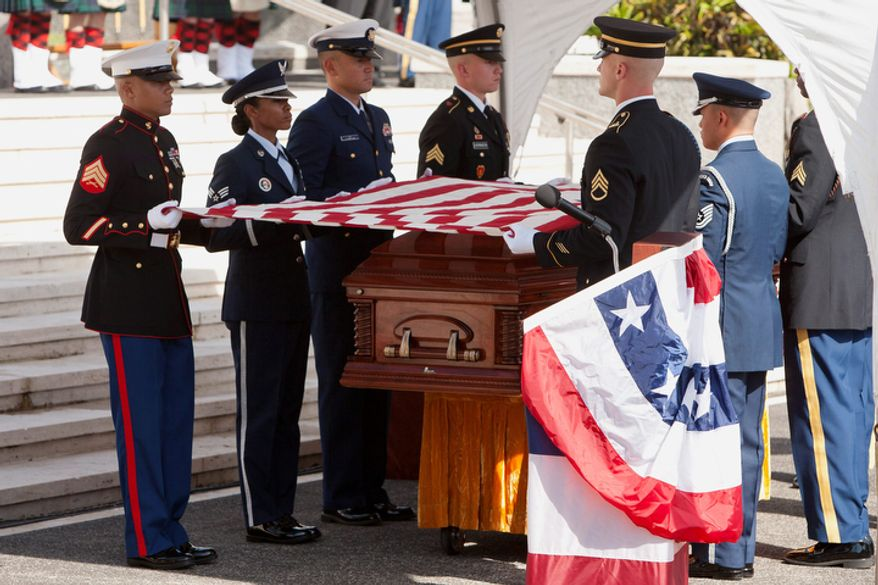 A U.S. military honor guard folds the flag over the coffin of U.S. Senator Daniel Inouye, D-Hawaii, during a memorial service at the National Memorial Cemetery of the Pacific, Sunday, Dec. 23, 2012 in Honolulu. (AP Photo/Marco Garcia)